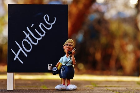 hotline sign with a secretary figurine