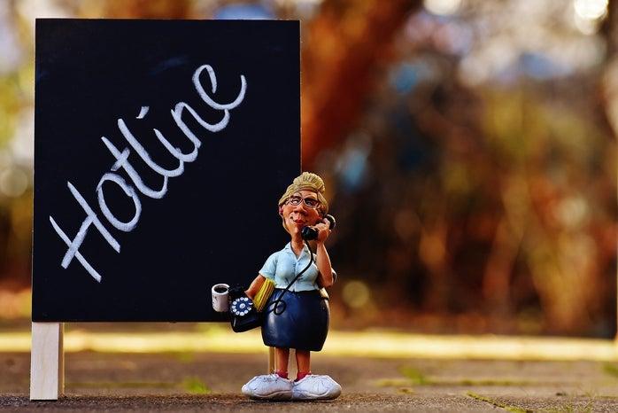 hotline sign with a secretary figurine
