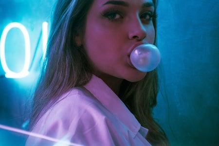 blue light background extra gum bubble girl