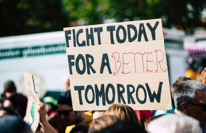 sign saying fight today for a better tomorrow