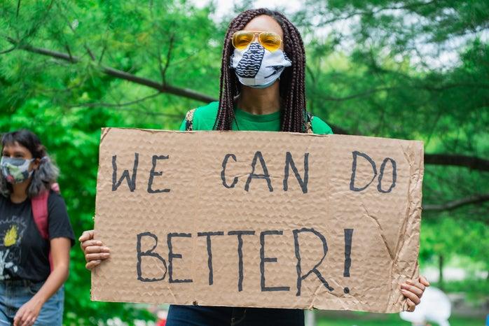 black lives matter protester holding sign