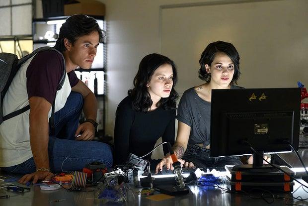 Three teenagers using a computer