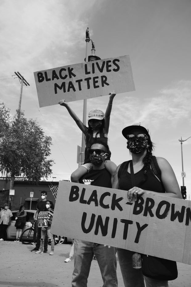 Protesters with Black Lives Matter/Black-Brown Unity signs