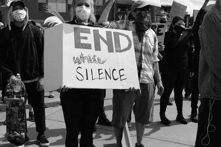 "Protesters with ""End White Silence"" signs"