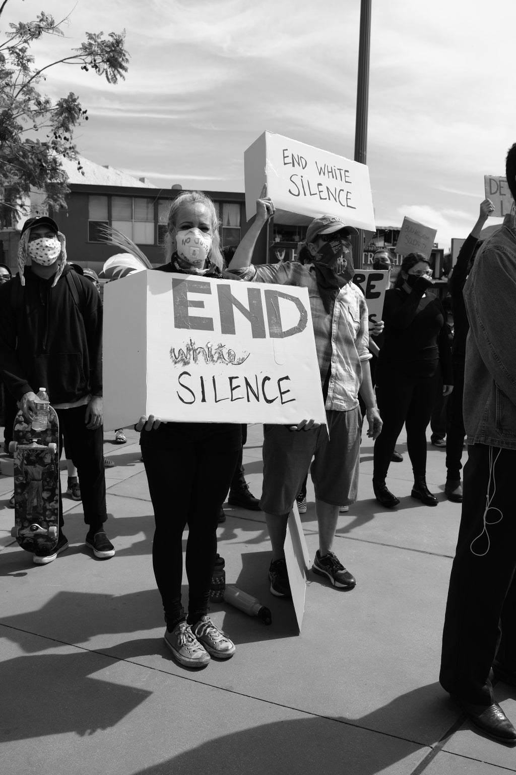 """Protesters with \""""End White Silence\"""" signs"""