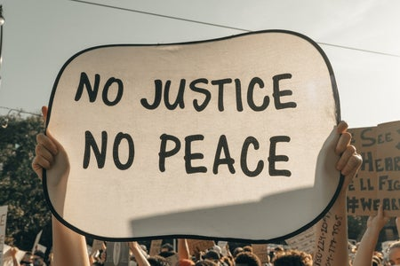 no justice no peace protest sign
