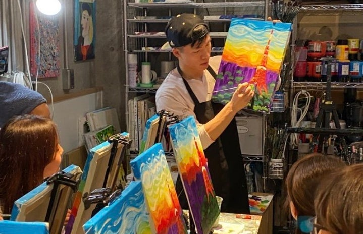 my friend teaching painting to a few students in Tokyo