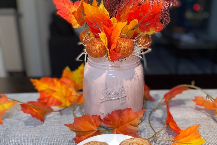 completed fall centerpiece with two pumpkin spice scones in front