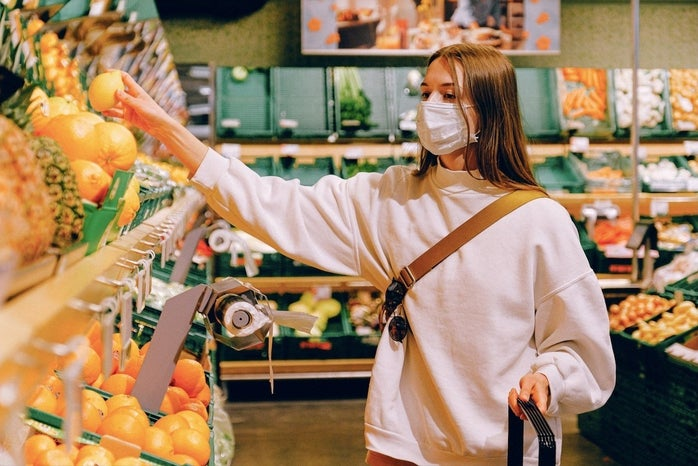 woman wearing mask while grocery shopping