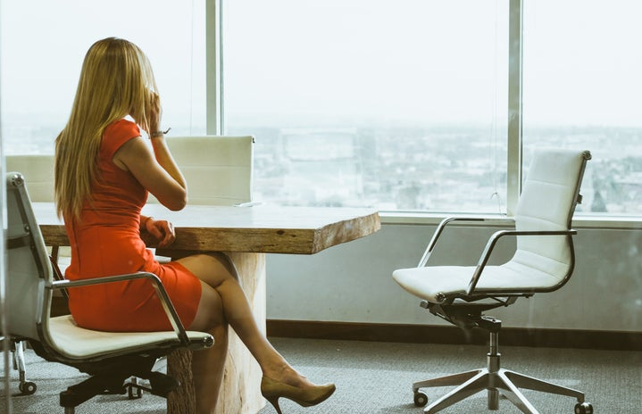 Working business woman in dress at office