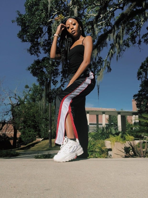 Girl posing in streetwear and chunky white Filas
