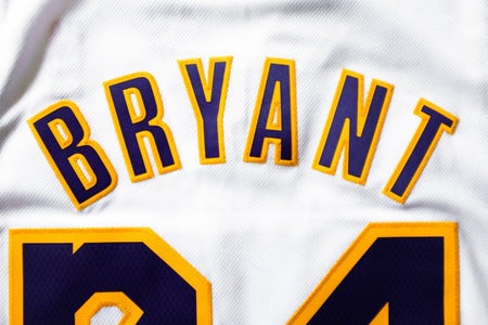 Kobe Bryant Lakers jersey; white, yellow and purple.