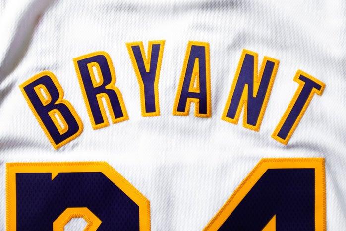 Kobe Bryant Lakers jersey; white, yellow and purple.