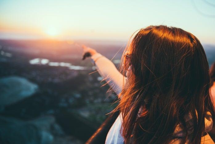 woman pointing to horizon