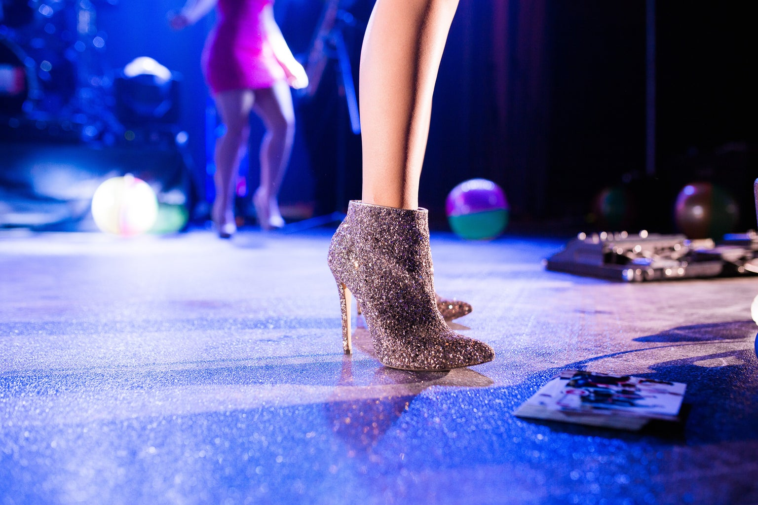 closer-up of person in silver glitter heels