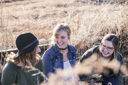 three women taking a groupie