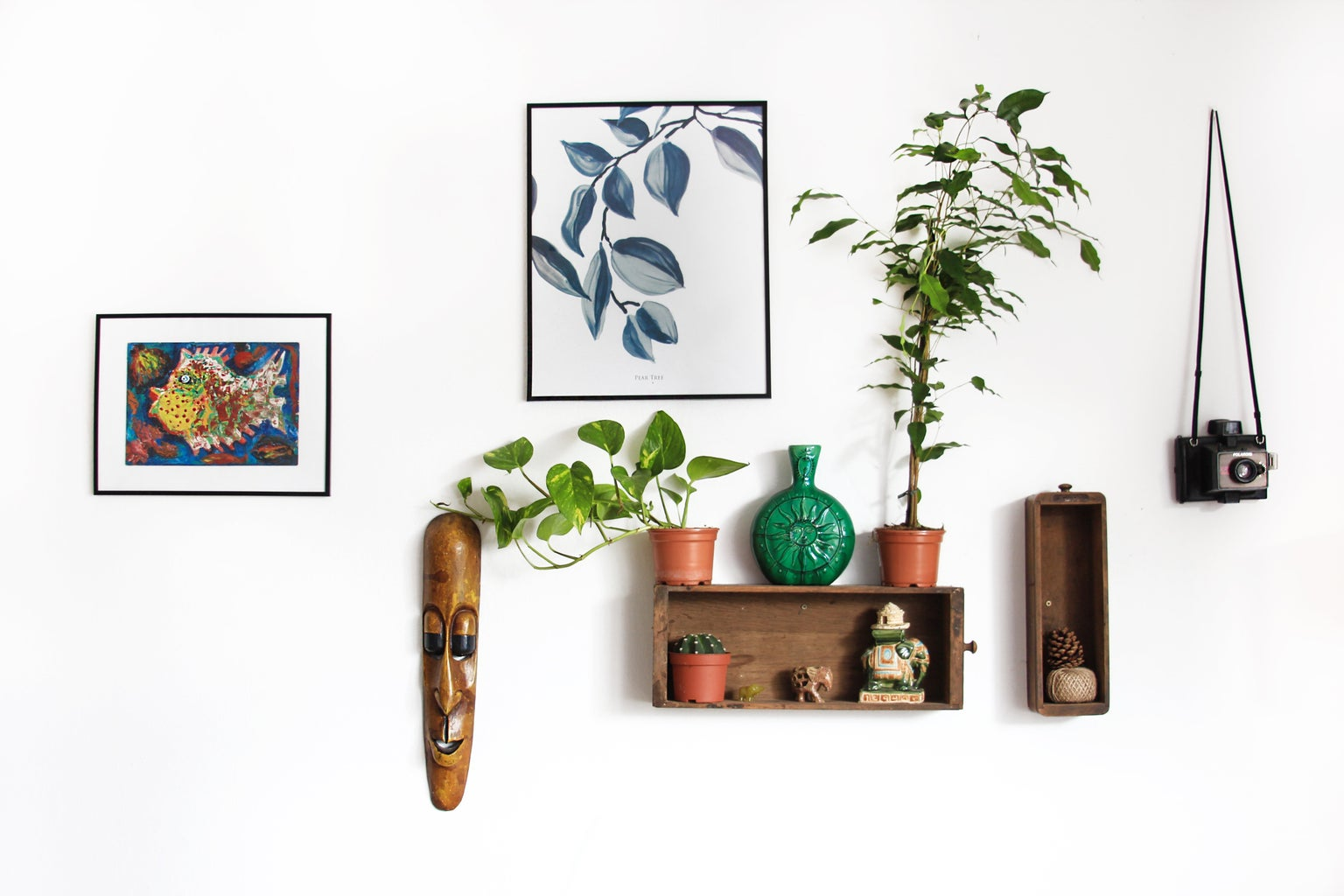 assorted decorations on a white wall