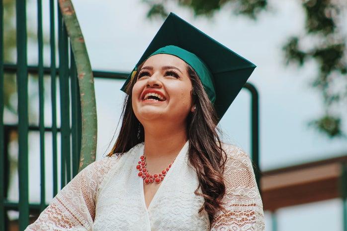 woman wearing green graduation cap