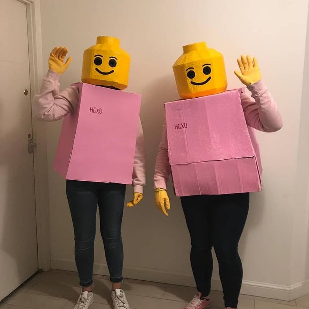two girls in lego person costumes