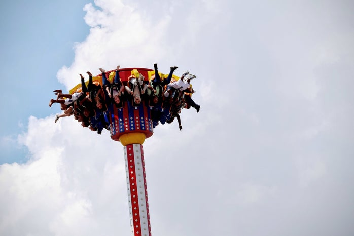 people riding on amusement park