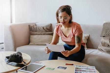 Woman studying photos