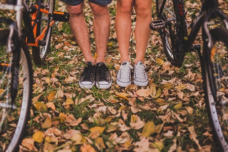two person standing between mountain bikes