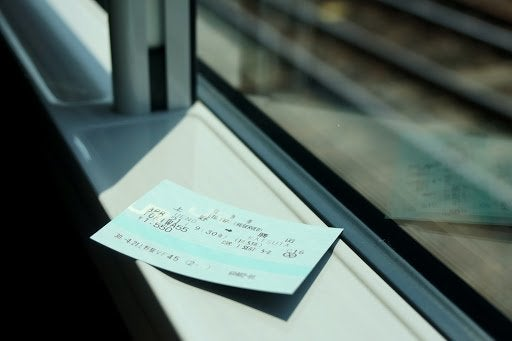 Japanese bullet train ticket on a window sill