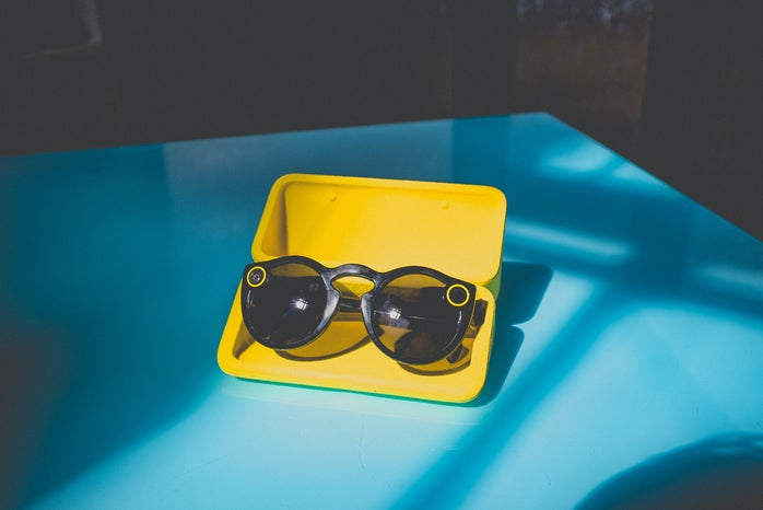 black sunglasses in yellow case on table