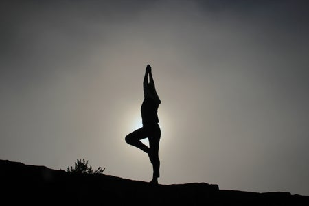 person doing yoga exercises