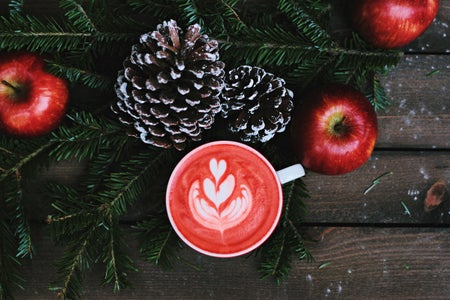 red coffee latte on white ceramic mug