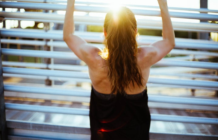woman doing pull up exercise