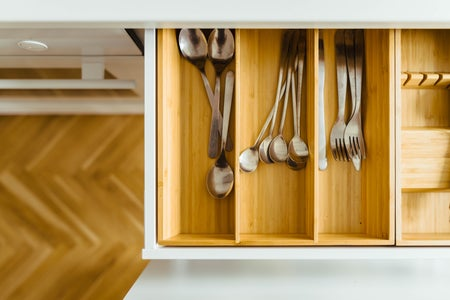 silver utensils in drawer