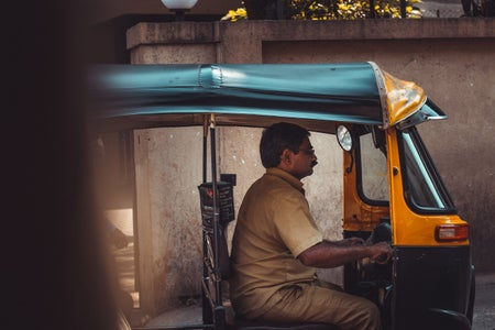 A day in the life on a rickshaw driver. Stuck in traffic.
