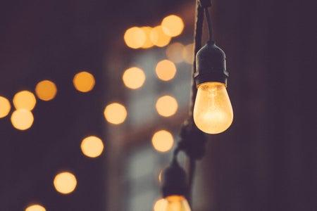low depth of field photo of string of lightbulbs