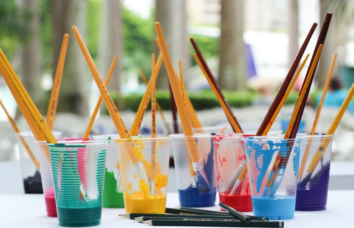 Paint Brushes Inside Clear Plastic Cups
