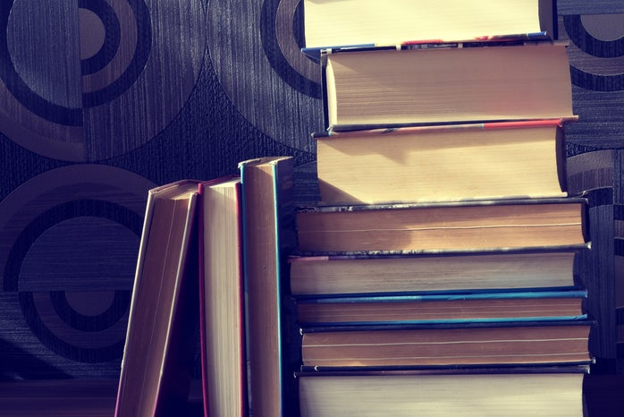 Assorted Books on Brown Surface