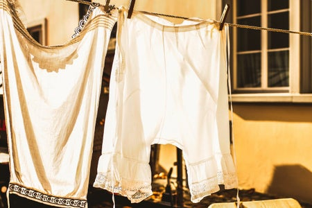 white laundry hanging to dry during golden hour