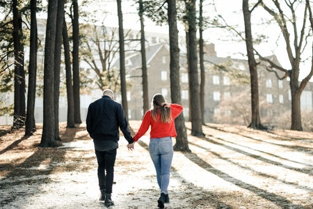 College couple holding hands