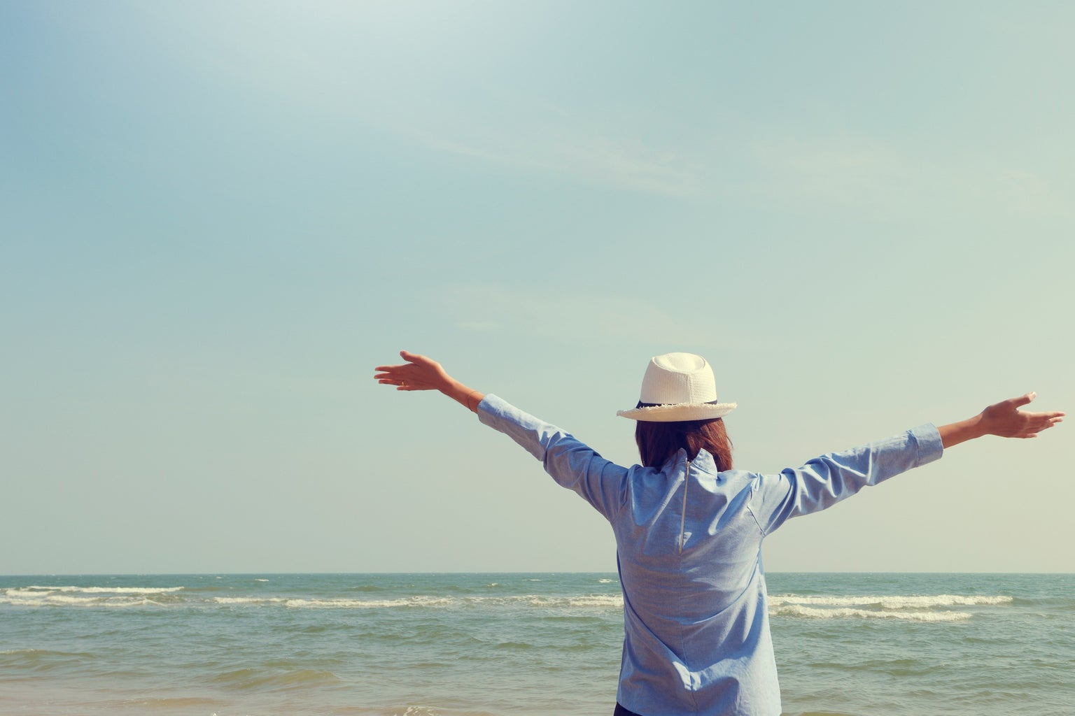 Woman Standing Facing Sea