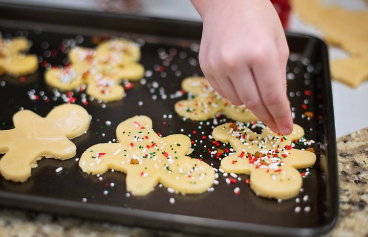 Person Baking Cookies on Tray