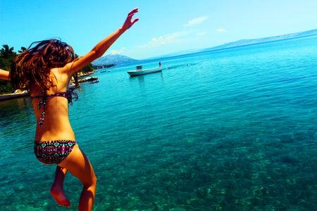 Woman Wearing Bikini Jumping to the Beach