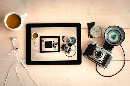 Gray SLR Camera and Black Tablet Computer