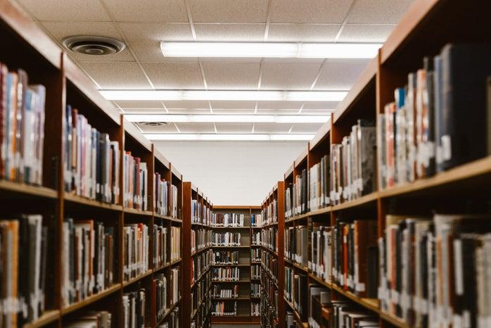 aisle between bookshelves in library