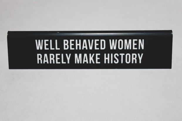 black placard stating on