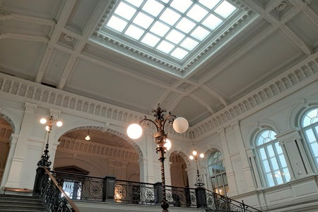 The Lobby in the Finnish National Gallery Ateneum. Staircase, lamps and skylight.