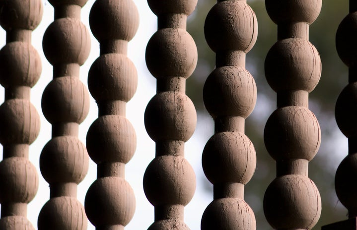 close-up of hanging wooden bead decor against outdoor background