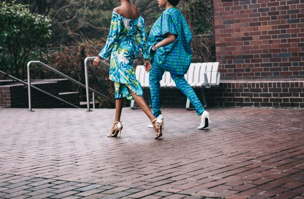two women in teal romper pants