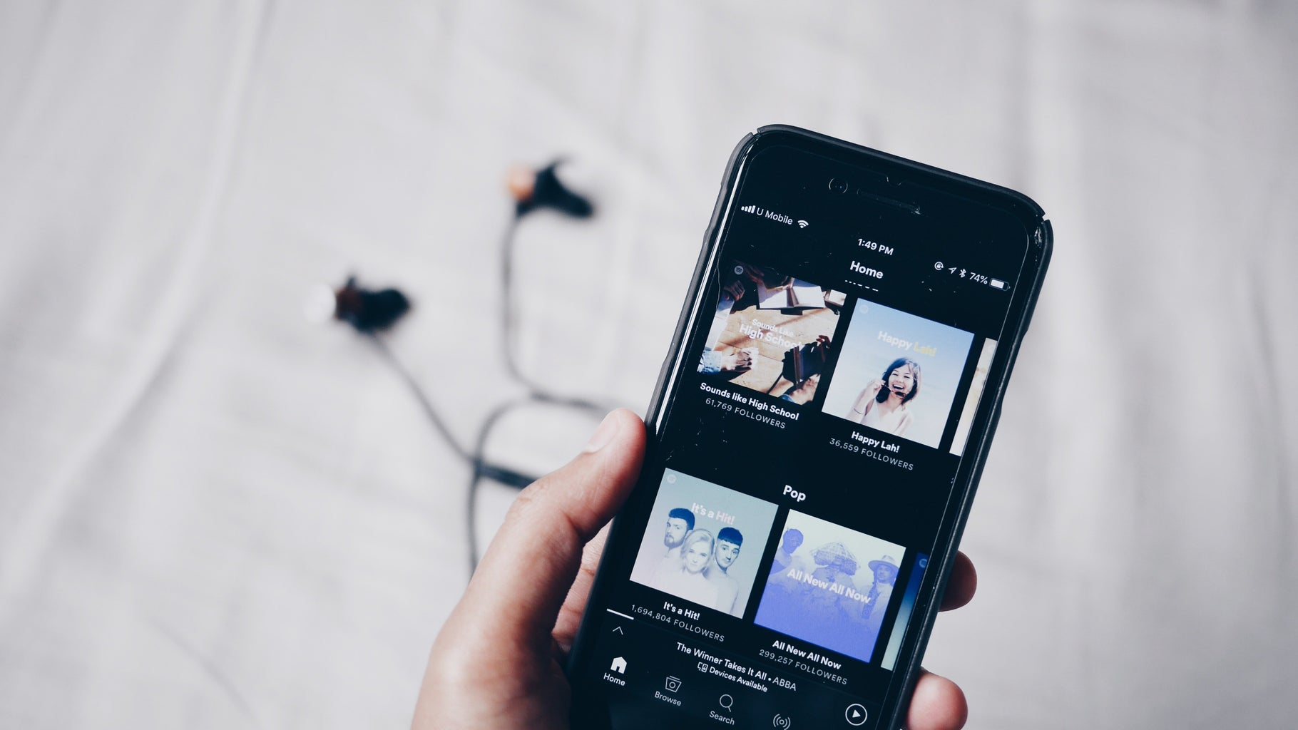 hand holding iphone showing spotify
