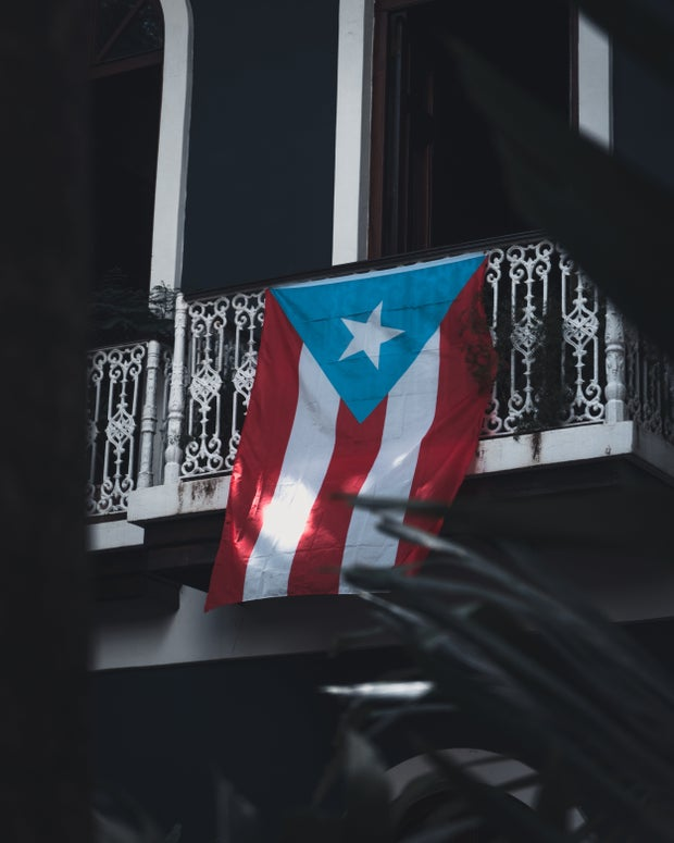 Puerto Rican flag hanging from a balcony