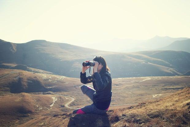 woman using binoculars at Golden Gate Highlands National Park, South Africa